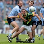 Killian Young is smothered by Barry Cahill and Bryan Cullen.