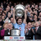 In front of Mary McAleese and Enda Kenny, Bryan Cullen lifts the trophy for the first time.