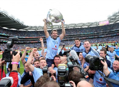 Dublin captain Bryan Cullen is held aloft by team mates as he celebrates with the Sam Maguire