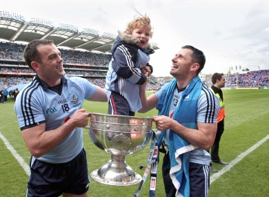 Jamie Brogan celebrates with his father, Alan, and Paul Casey.