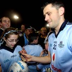 Dublin's Alan Brogan signs autographs after the game.