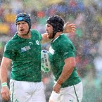 Jamie Heaslip congratulates Sean O'Brien in the rain after he scored a try.