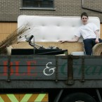 Ciaran Fagan, 14, with his parents' bedding and household furniture being removed from their home on the back of a lorry