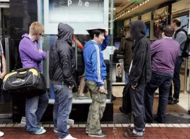 Customers line up to buy the iPhone 4 as it goes on sale in 2010.