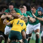 Stephen Ferris picks up Australian scrum-half Will Genia and drives him back towards his own line.