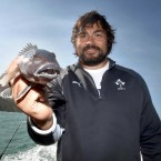 Tony Buckley shows off his catch following a team fishing trip.