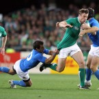 Ireland's Tommy Bowe tackled by Luciano Orquera and Gonzalo Garcia.