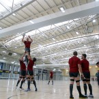 The Irish team practice their line-outs in an indoor training centre.