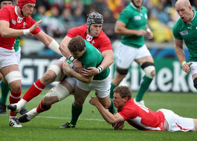 Brian O'Driscoll tackled by Dan Lydiate and Rhys Priestland  8/10/2011