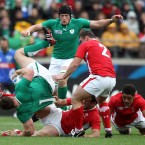 Ireland's Cian Healy tackled by Rhys Priestland of Wales.