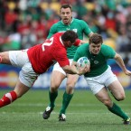 Ireland's Brian O'Driscoll tackled by Huw Bennett.