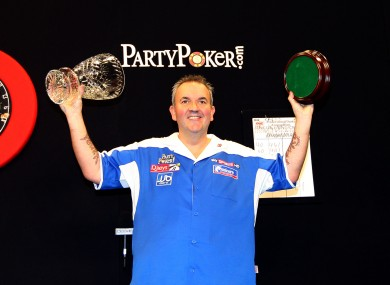 Phil Taylor celebrates with the trophy at Citywest last night.