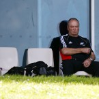 New Zealand coach Graham Henry sits and thinks.