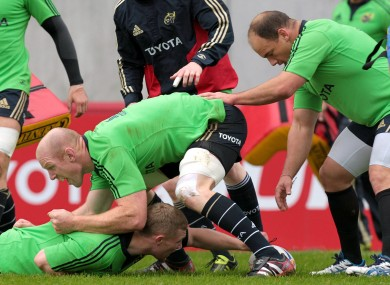 Paul O'Connell gets stuck in at Munster training this week.