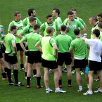 The Irish side huddle up.