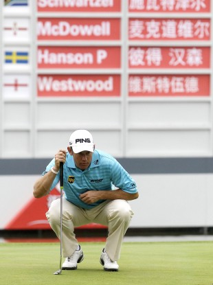 Lee Westwood  prepares to putt on the 18th green.