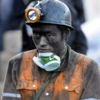 A Chinese rescuer looks on at the Sizhuang Coal Mine where a gas outburst killed 20 miners and trapped 23 others in Qujing city on Thursday. 