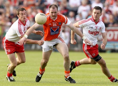 Tyrone's Brian McGuigan and Philip Jordan with Ciaran McKeever of Armagh last summer.