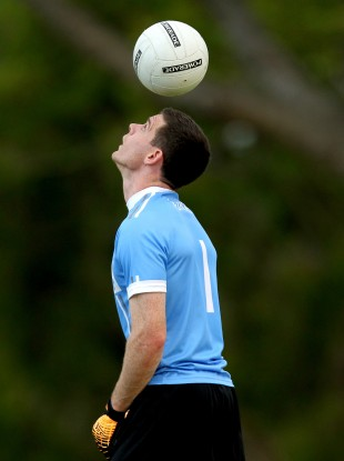 Captain Stephen Cluxton juggles the ball during training at the RACV Royal Pines Resort on the Gold Coast.