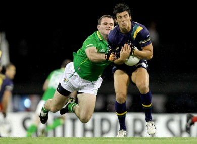 Ireland's Neil McGee and Anguis Monfries of Australia.