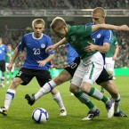 Damien Duff tussles with Kaimar Saag of Estonia.