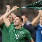 Skipper Robbie Keane leads the team in celebration.