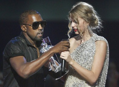 Kanye West takes the microphone from singer Taylor Swift as she accepts the