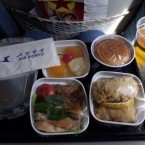 Skytrax rates the food at 1-star for economy and 2-star for business class. Most reviewers say that it's edible, but nothing special.