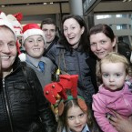Paula Rooney (centre) is surrounded by her family and friends after returning home from Vancouver, Canada. Photo Mark Stedman/Photocall Ireland