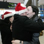 Paula Rooney originally from Ringsend, Dublin is greeted home by her father John and sister Georgina Montgomery today in T2 at Dublin Airport after returning home from Vancouver, Canada, after nearly two years. Photo Mark Stedman/Photocall Ireland