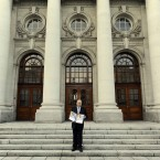 Michael Noonan poses with a hard copy of his Budget for 2012 on the steps of Government Buildings before presenting it to the Dail. Photo Laura Hutton/Photocall Ireland