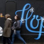 Members of the public pass by a mural in the Liberties area of Dublin as Finance Minister Michael Noonan prepared to announce the second half of Budget 2012 Photo: Julien Behal/PA Wire