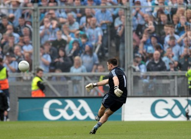 Stephen Cluxton kicks the winning point against Kerry. 