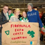 Fionnuala Britton arrives back in Dublin Airport and is greeted by Des Earls, her sister Una Britton, Deirdre McDermott and Declan Monaghan from Kilcoole Athletic Club.