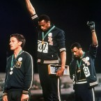 USA athletes Tommie Smith, centre, and John Carlos stare downward during the playing of the Star Spangled Banner and give the Black Power salute with gloved hands as a civil rights protest.