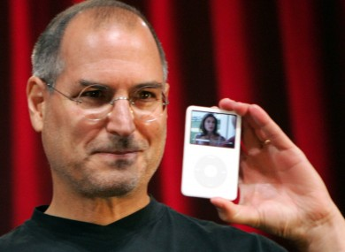 Jobs, pictured outside his home with an iPod