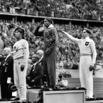 America's Jesse Owens, centre, taking gold for the long jump. Nazi Germany's Lutz Long, right, took silver. Adolf Hitler decided to skip his medal presentations (Owens went on to win four gold in total in 1936).
