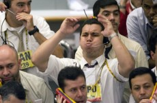 Markets dip over eurozone worries after S&P downgrades