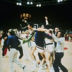 USA basketball team players enjoy a brief moment of elation when they thought they had beaten the Soviets, but the referee reset the clock by three seconds and the Soviet Union scored a final goal to win the game 51-50.
