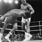 Challenger Muhammad Ali watches as defending world champion George Foreman goes down to the canvas in the eighth round of their WBA/WBC championship match in Kinshasa, Zaire - dubbed