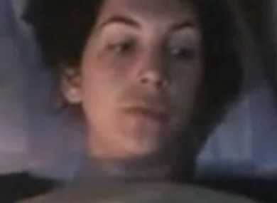 A still image of injured French journalist Edith Bouvier taken from the video below.