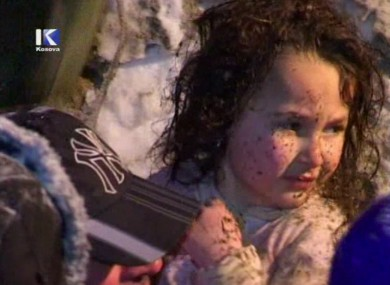A TV still of the young girl after she was pulled from the rubble of an avalanche-struck house today.