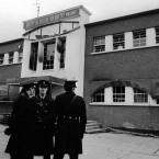 Gardaí stand outside the main entrance of a fire-blackened Stardust on 14 February 1981.