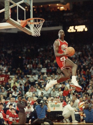 Jordan dunks the ball during the Slam-Dunk championship in Chicago on Saturday, Feb. 6, 1988