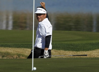 Spencer Levin celebrates as his ball drops for an eagle at the 17th.