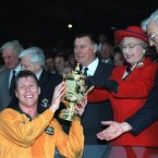 1991 brought the first visit of the Rugby World Cup to the Northern Hemisphere - with England making it as far as the final before losing to Australia, who themselves had only narrowly overcome Ireland. Here the Queen presents the William Webb Ellis cup to Australian captain Nick Farr-Jones at Twickenham.