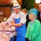 Perhaps the singly most iconic photograph of the Royal visit. Fishmonger Pat O'Connell keeps Her Majesty amused during her visit to the English Market on the last day of her visit.