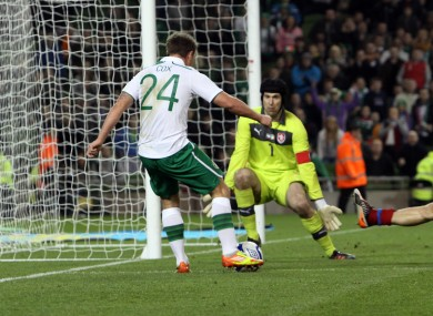 Simon Cox scores Ireland's equaliser four minutes from time.
