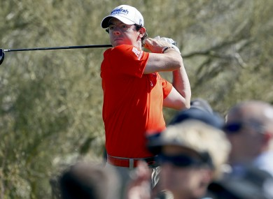 Rory McIlroy tees off on the 14th hole while playing South Korea's Bae Sang-moon.