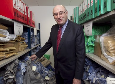 Phil Hogan looks happily at postbags filled with household charge forms